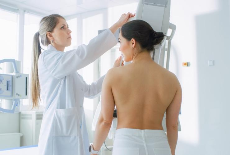 Doctor performing mammogram screening