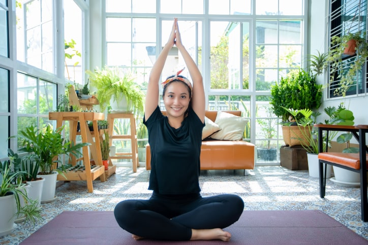 Happy lady doing yoga